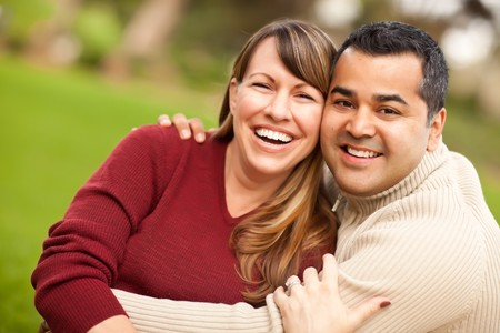 mixed race couple: Attractive Mixed Race Couple Portrait in the Park. Stock Photo