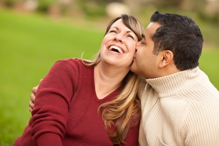 mixed couple: Attractive Mixed Race Couple Portrait in the Park. Stock Photo