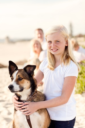 Cure Girl Playing with Her Dog at the Beach. photo