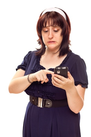 Reluctant Young Caucasian Woman Pushing Button on Her Mobile Phone.  photo