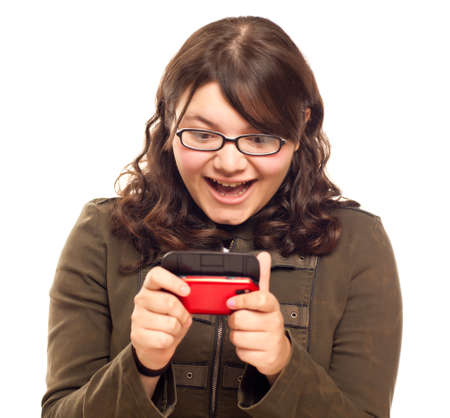 Excited Young Caucasian Woman Texting on Her Mobile Phone Isolated on White.  photo