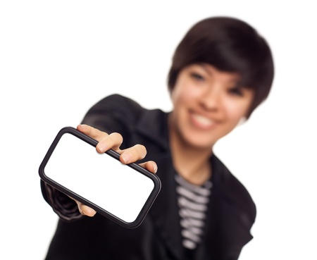 Smiling Young Mixed Race Woman Holding Blank Smart Phone Out - Focus is On the Phone Ready for Your Own Message. photo