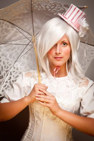 Pretty White Haired Woman Wearing Classic Dress with Parasol and Small Top Hat. Stock Photo - 8318696