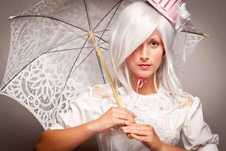 Pretty White Haired Woman Wearing Classic Dress with Parasol and Small Top Hat. Stock Photo - 8318705