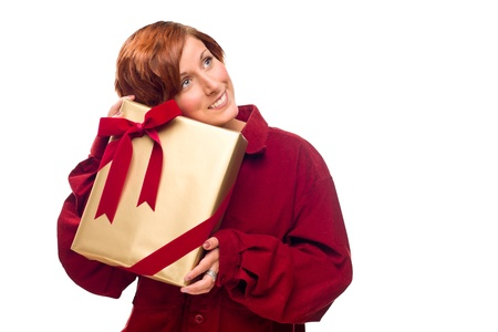 Pretty Red Haired Girl Rests Her Head on a Precious Wrapped Gift Isolated on a White Background. Stock Photo - 8318683
