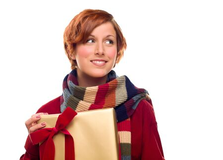 Pretty Red Haired Girl with Scarf Holding Wrapped Gift Looking Off to the Side Isolated on a White Background. Stock Photo - 8318681