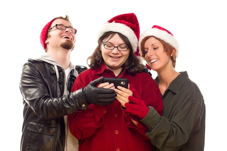 Three Friends Enjoying A Cell Phone Together Isolated on a White Background. photo