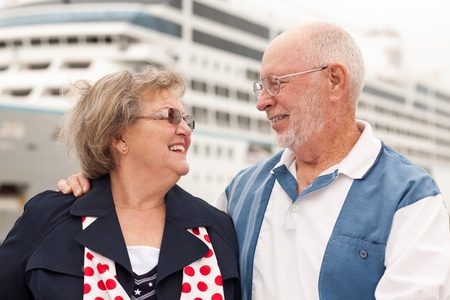 Senior Couple On Shore in Front of Cruise Ship While on Vacation. photo