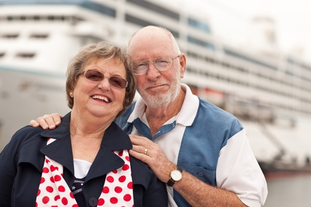cruise: Senior Couple On Shore in Front of Cruise Ship While on Vacation.