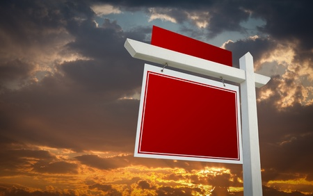 Blank Red Real Estate Sign Over Sunset Sky Ready For Your Own Message. photo