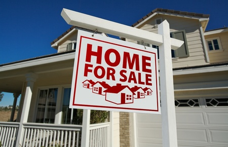 sales agent: Red Home For Sale Real Estate Sign and House Against a Blue Sky. Stock Photo