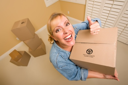 sweats: Excited Woman with Thumbs Up and Moving Boxes in Empty Room Taken with Extreme Wide Angle Lens.
