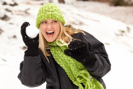 Attractive Woman Having Fun in the Snow on a Winter Day. Stock Photo - 8688944