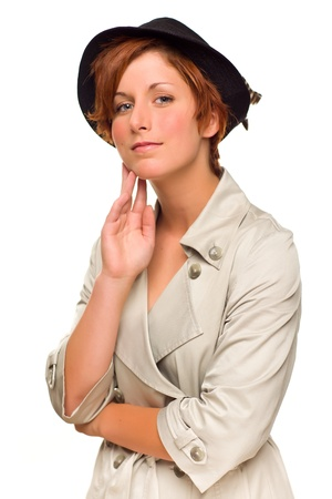 Attractive Red Haired Girl Wearing a Trenchcoat and Hat Isolated on a White Background. Stock Photo - 8923989