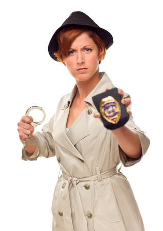 Red Haired Female Detective With Handcuffs and Badge In Trenchcoat Isolated on a White Background. photo