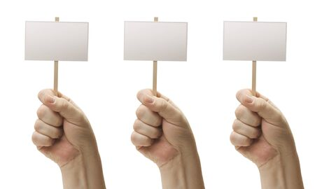 Three Blank Signs In Male Fists Isolated on a White Background. Stock Photo - 9093807