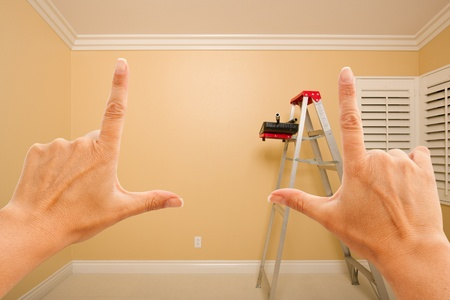 Female Hands Framing Beautiful Room Interior Imagining What to Do with the Room. Stock Photo - 9093823