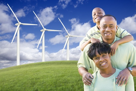 Happy African American Family and Wind Turbine with Dramatic Sky and Clouds. Stock Photo - 9169617