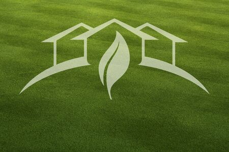 environmental awareness: Green House with Leaf Ghosted Over Fresh Cut Grass.