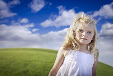 blue eyed: Adorable Blue Eyed Girl Playing Outside in the Grass Field.