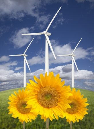 Wind Turbines Against Dramatic Sky, Clouds and Bright Sunflowers in the Foreground. photo