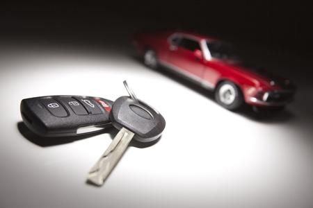 Car Keys and Sports Car Under Spot Light. photo