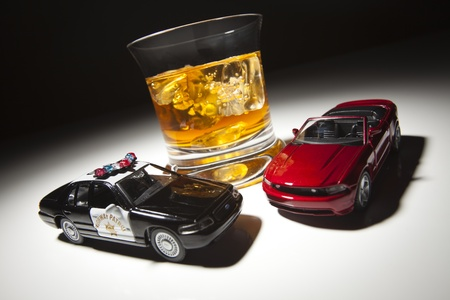 dui: Police and Sports Car Next to Alcoholic Drink Under Spot Light.