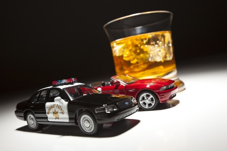 Police and Sports Car Next to Alcoholic Drink Under Spot Light. photo