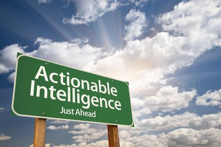 cia: Actionable Intelligence Green Road Sign on Dramatic Blue Sky with Clouds.