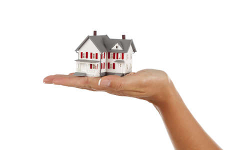 Model House in Female Hand Isolated on a White Background. photo