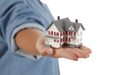 Model House in Female Hand Isolated on One Side with a White Background. photo