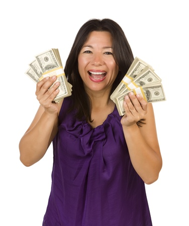 american money: Excited Attractive Multiethnic Woman Holding Hundreds of Dollars Isolated on a White Background.