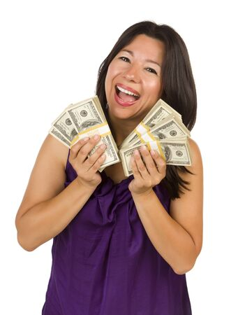 abundance money: Excited Attractive Multiethnic Woman Holding Hundreds of Dollars Isolated on a White Background.