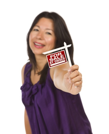 Attractive Multiethnic Woman Holding Small For Sale By Owner Real Estate Sign in Hand Isolated on White Background. Stock Photo - 9812611