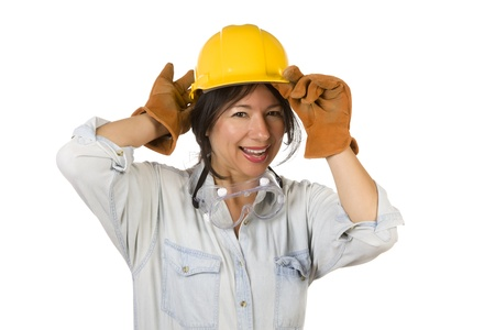 Attractive Smiling Hispanic Woman Wearing Hard Hat, Goggles and Leather Work Gloves Isolated on a White Background. Stock Photo - 9923139