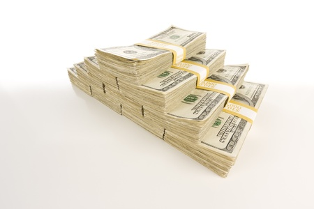 stack of cash: Stacks of One Hundred Dollar Bills Isolated on Gradation.