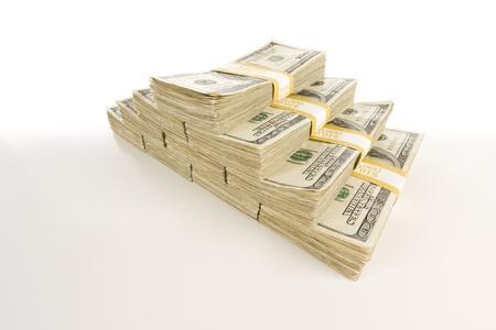 Stapel von hundert Dollarnoten lokalisiert auf Abstufung. Standard-Bild