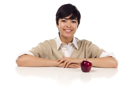 chinese adult: Smiling Mixed Race Young Adult Female Sitting at White Table with Apple Isolated on a White Background.