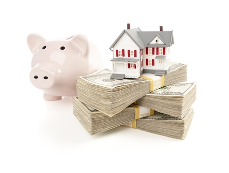 in escrow: Small House and Piggy Bank with Stacks of Hundred Dollar Bills Isolated on a White Background.