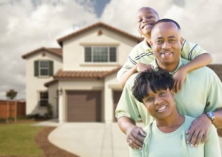 front or back yard: Attractive African American Family in Front of Beautiful House. Stock Photo