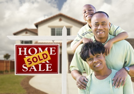 real estate sold: Happy African American Family in Front of New House and Sold Real Estate Sign.