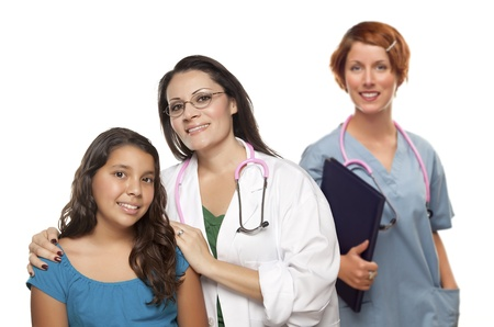 Pretty Hispanic Female Doctor with Child Patient and Colleague Behind Isolated on a White Background. photo