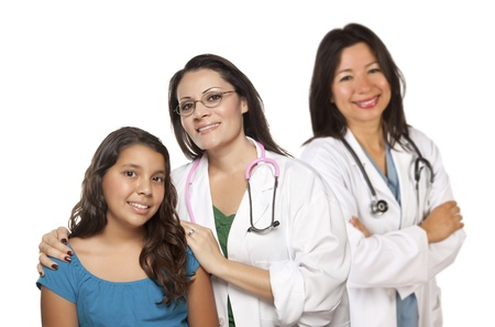 latino: Pretty Hispanic Female Doctor with Child Patient and Colleague Behind Isolated on a White Background.