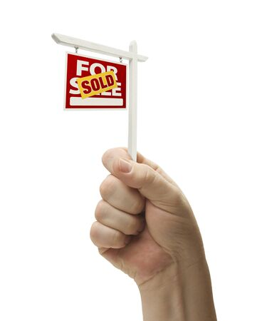 Sold For Sale Real Estate Sign In Male Fist Isolated On a White Background. photo