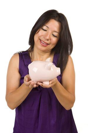Smiling Hispanic Woman Holding Piggy Bank Isolated on a White Background. photo