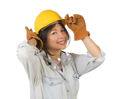 Attractive Smiling Hispanic Woman Wearing Hard Hat, Goggles and Leather Work Gloves Isolated on a White Background. photo