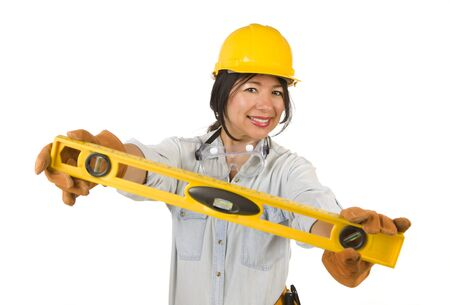 hard: Attractive Hispanic Woman with Hard Hat Holding Level Isolated on a White Background.