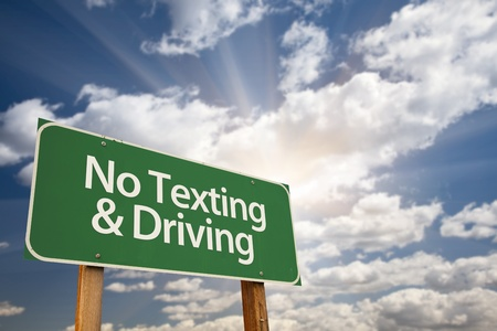 No Texting and Driving Green Road Sign with Dramatic Sky, Clouds and Sun. Stock Photo - 10577220