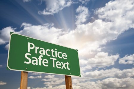 Practice Safe Text Green Road Sign with Dramatic Sky, Clouds and Sun. photo