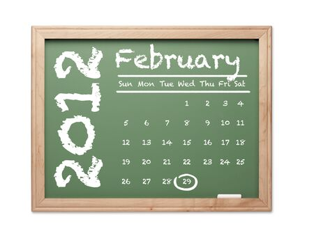 Month of February 2012 Calendar on Green Chalkboard Over White Background. photo
